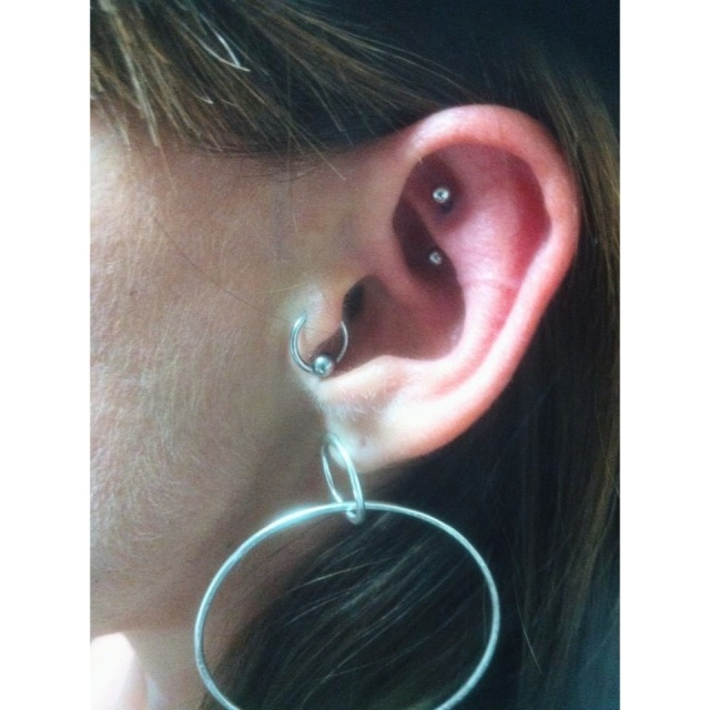 Rook Piercing w/ 1.2mm X 8mm curved bar,