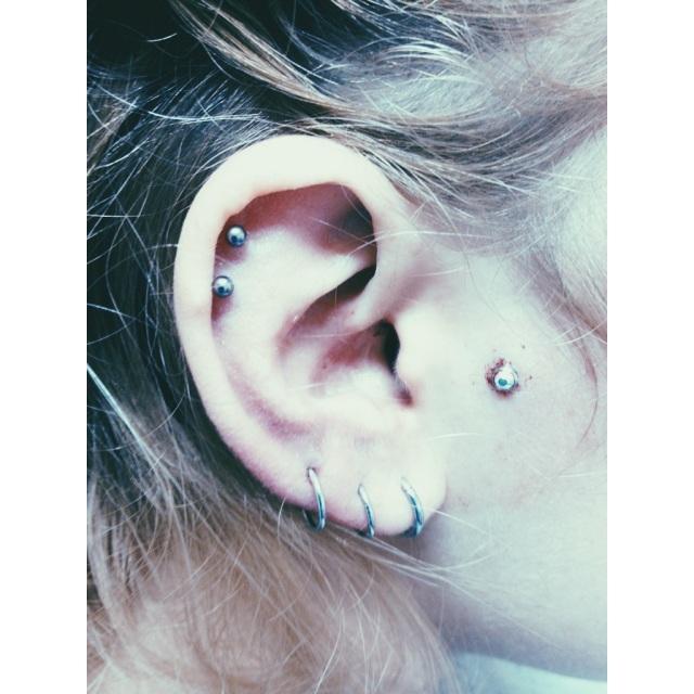 Terri's Double Top Ear Piercings & Face Dermal