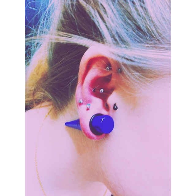 Fresh Conch Piercing & 12mm Lobe Stretch among others.