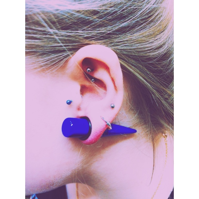 Sophie's Left Ear w/fresh 12mm stretch among other piercings by El Capitan.