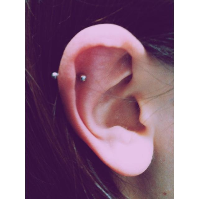 Top Ear Cartilage Rim Piercing