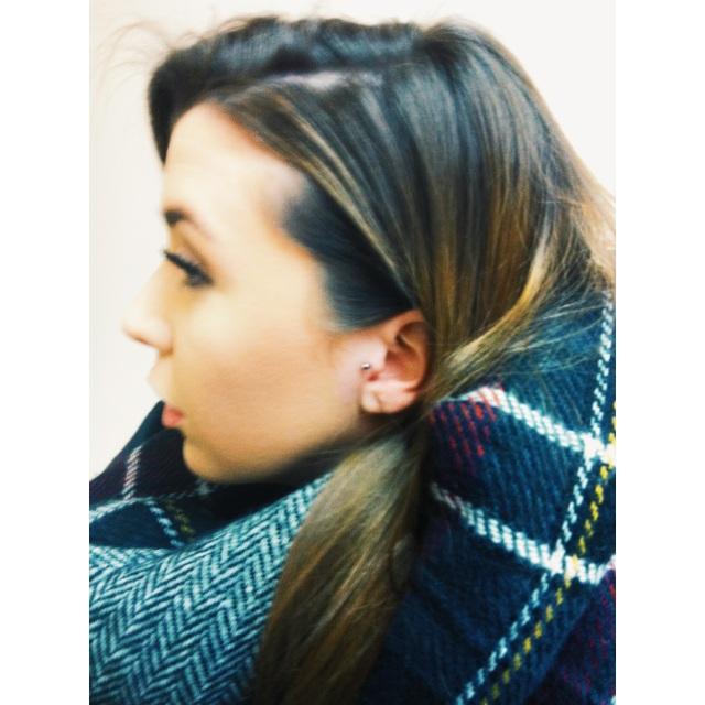 Jess' Tragus Piercing