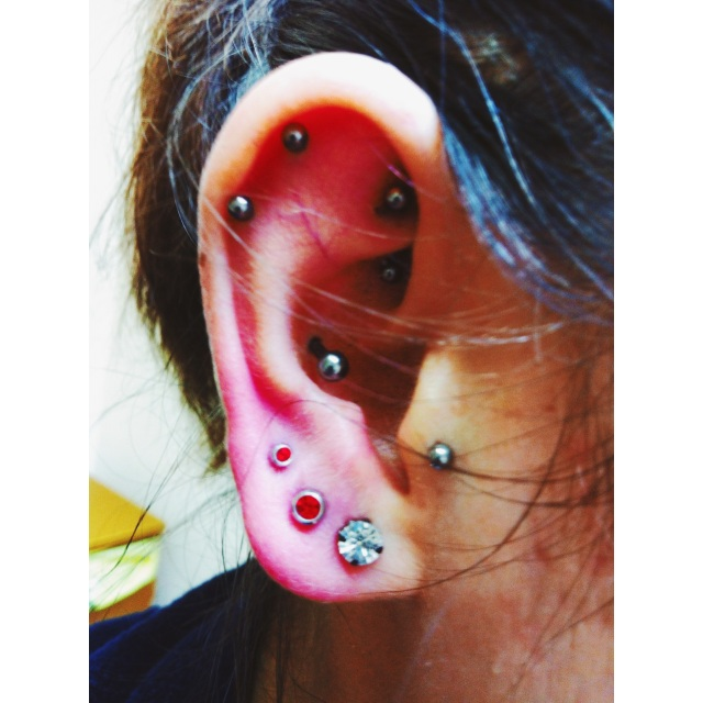 Georgie's Tragus, Rook, Conch & Lobe Piercings